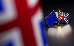 LONDON, UNITED KINGDOM - MARCH 17:  In this photo illustration, the European Union and the Union flag are pictured on a pin badge on March 17, 2016 in London, United Kingdom. The United Kingdom will hold a referendum on June 23, 2016 to decide whether or not to remain a member of the European Union (EU), an economic and political partnership involving 28 European countries which allows members to trade together in a single market and free movement across its borders for citizens.  (Photo by Dan Kitwood/Getty Images)