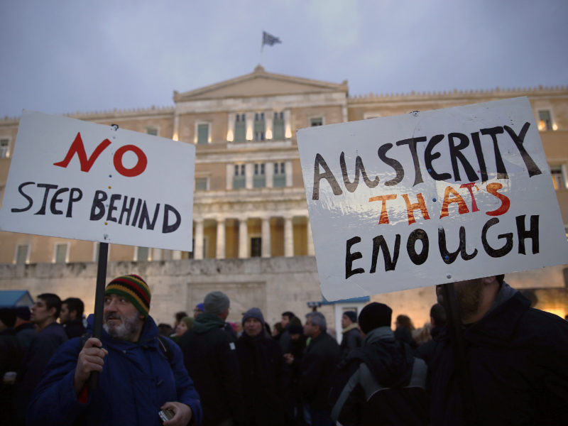 Protesters take part in an anti-austerity pro-government demonstration in front of the parliament in Athens February 11, 2015. Thousands of Greeks took to the streets of Athens on Wednesday to support their new anti-austerity government which was locked in tough negotiations with euro zone partners in Brussels. REUTERS/Yannis Behrakis (GREECE - Tags: POLITICS BUSINESS CIVIL UNREST) - RTR4P7AN