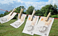 Why is the government failing to act on its 'robust rhetoric' on dirty money?