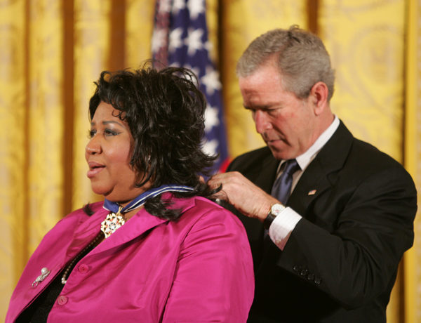 President George W. Bush presents Aretha Franklin with the Presidential Medal of Freedom Wednesday, Nov. 9, 2005, during ceremonies in the East Room of the White House. Photo by Paul Morse, Courtesy of the George W. Bush Presidential Library and Museum