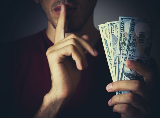 Bribery,People,With,Dollar,Bills,In,Hand,And,Quiet,Gesture